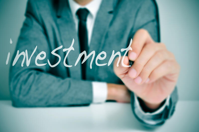 bigstock-businessman-sitting-in-a-desk--59222081